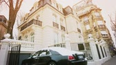 limousine : STRASBOURG, FRANCE - CIRCA 2018: Luxury Rolls-Royce Ghost parked in front of expensive French real estate house in central of French city - car covered with snow - cinematic colors