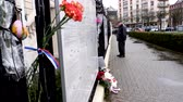 stožár : STRASBOURG, FRANCE - MAR 28, 2018: Carnation flower with Russian Flag band at Russian Consulate Embassy mourning victims fire at Zimnyaya Vishnya Winter Cherry shopping centre Kemerovo - senior man