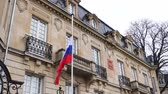 consulate : STRASBOURG, FRANCE - MAR 28, 2018: Flag of Russia flying half-mast ar Russian Consulate Embassy - tribute and mourning of victims of fire at Zimnyaya Vishnya  shopping centre Kemerovo - cinematic