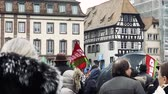 place kleber : STRASBOURG, FRANCE  - MAR 22, 2018: Crowd with flags in Place Kleber at demonstration protest against Macron French government string of reforms, trade unions of public workers to strike