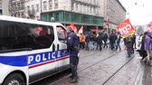 french street : STRASBOURG, FRANCE  - MAR 22, 2018: Police van surveillance of people at demonstration protest against Macron French government string of reforms, multiple trade unions have called workers to strike-