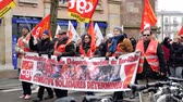 demonstrators : STRASBOURG, FRANCE - MAR 22, 2018: Placard with CGT General Confederation of Labor workers with placard at demonstration protest against Macron French government string of reforms Stock Footage