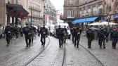 french communist party : STRASBOURG, FRANCE  - MAR 22, 2018: Police force surveillance of demonstration protest against Macron French government string of reforms, multiple trade unions have called public workers to strike-
