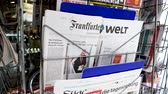 presidential candidate : PARIS, FRANCE - MAR 19, 2017: German Frankfurter Allgemeine Zeitung and Die Welt newspapers at press kiosk featuring Russian presidential election from 2018 with the winner Vladimir Putin