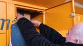 штрих код : PARIS, FRANCE - FEB 15, 2017: Senior male opening door of the Amazon Locker orange delivery parcel package locker Amazon Locker is a self-service parcel delivery service offered by online retailer Amazon.com. Amazon customers can select any Locker locatio