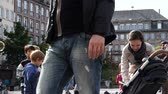 sopro : STRASBOURG, FRANCE - CIRCA 2017: Mother taking baby from stroller as kids jumping and playing with the soap bubbles in central square of Strasbourg, European Capital in Place Kleber slow motion city