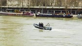 afet : PARIS, FRANCE - JAN 30, 2018: Prefecture de Police boat with police officers and rescue team surveilling the flooded Seine river in Paris during the floods after heavy rains - iconic Eiffel Tower seen in the background Stok Video