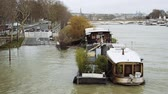 french street : PARIS, FRANCE - JAN 30, 2018: Aerial view of houseboat barge peniche on the overflow flooding embankments on the Seine river in Paris after heavy rain