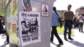 gare : STRASBOURG, FRANCE - MAY 5, 2018: People making a party protest Fete a Macron in front of Gare de Strasbourg  poster calling to party