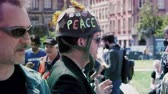 gare : STRASBOURG, FRANCE - MAY 5, 2018: People making a party protest Fete a Macron party for Macron - man with military helmet with peace text printed on protection hat slow motion Stock Footage
