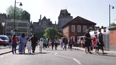 harry : WINDSOR, BERKSHIRE, UNITED KINGDOM - MAY 19, 2018: Group of travelers walking to royal wedding marriage celebration of Prince Harry and Meghan Markle to Windsor Castle Stock Footage