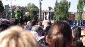 harry : WINDSOR, UNITED KINGDOM - MAY 19, 2018: Big crowd of people walking from train station to central Windsor Castle to Royal wedding marriage of Prince Harry and Meghan Markle