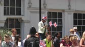 bastante : WINDSOR, BERKSHIRE, UNITED KINGDOM - MAY 19, 2018: Black ethnicity boy on shoulders raised enough to see royal wedding marriage celebration of Prince Harry and Meghan Markle - waiving union jack flag