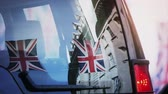 harry : Cinematic reflection of Union Jack Flags on Regent Street a day before Royal Wedding between Prince Harry and Meghan Markle will be held at Windsor Castle