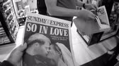 интерес : LONDON, UK - MAY 20, 2018: POV The Sunday Express front cover newspaper British press kiosk featuring portraits of Prince Harry Meghan Markle Royal Wedding So In Love - black and white, two people
