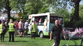 road : WINDSOR, UNITED KINGDOM - MAY 19, 2018: Queue at the Ice Cream van in Long Road Park at royal wedding marriage celebration of Prince Harry and  Meghan Markle