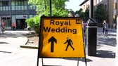 harry : WINDSOR, BERKSHIRE, UNITED KINGDOM - MAY 19, 2018: A Royal Wedding road sign is seen in central Windsor on the day of the royal wedding of Prince Harry and Meghan Markle