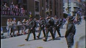 princ : WINDSOR, UNITED KINGDOM - MAY 19, 2018: VHS old film of crowd applauding MET police march in street around Windsor Castle after procession celebrate wedding of Prince Harry of Wales and Ms Meghan Markle