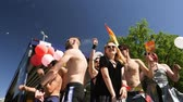 hoşgörü : STRASBOURG, FRANCE - JUN 10, 2017: excited dancing of gay men and women people with rainbow flag behind in slow motion at Lesbian Gay Bisexual Transgender LGBT visibility march pride on gay truck Stok Video