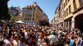 transgender : FRANCE - JUN 10, 2017: Ultrawide French street thousands people jumping dancing gay supporters with rainbow flag slow motion Lesbian Gay Bisexual Transgender LGBT GLBT visibility march pride FestiGays Stock Footage