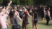hoşgörü : STRASBOURG, FRANCE - JUN 10, 2017: Dancing crowd of LGBT Gay people being playful in water fountain  dancing with rainbow flag in slow motion at Lesbian Gay Bisexual visibility march pride FestiGays Stok Video