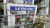 él : PARIS, FRANCE - JUNE 13, 2018: Le Figaro newspaper at press kiosk showing on cover  U.S. President Donald Trump meeting North Korean leader Kim Jong-un in Singapore