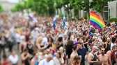 hoşgörü : STRASBOURG, FRANCE - JUN 10, 2017: Cinematic tilt-shift lens used at LGBT gay pride parade with thousands of people dancing on the street - elevated view crowd waving rainbow flag