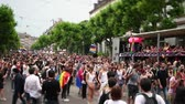 hoşgörü : STRASBOURG, FRANCE - JUN 10, 2017: Crowd near Gay truck in city center at gay LGBT pride - tilt-shift lens with thousands of people dancing on the street - elevated view