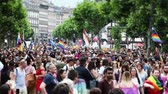 igualdade : STRASBOURG, FRANCE - JUN 10, 2017: Cinematic focusing with tilt-shift lens used at LGBT gay pride parade with thousands of people dancing on the street - elevated view