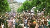 hoşgörü : STRASBOURG, FRANCE - JUN 10, 2017: Cinematic flare over tilt-shift lens used at LGBT gay pride parade with thousands of people dancing on the street