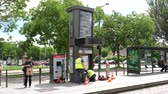 клиент : STRASBOURG, FRANCE - CIRCA 2018: Public transportation improvement - Installation by professional team of workers of the new ticket vending machine in tramway station Wacken in Strasbourg