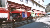 marco : STRASBOURG, FRANCE - JUN 30, 2018: CINTRA Chez Marco traditional French pub serving food and drinks in Strasbourg, France with terrace full with people watching World Cup 2018 soccer football