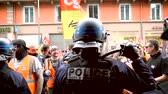 asa : STRASBOURG, FRANCE - JUN 20, 2018: Police officer at French protest SNCF French train worker demonstration strike against Macron government ready use the police bat rubber baton Stok Video