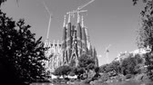 art noveau : Cinematic black and white of Sagrada Familia Church built by Antoni Gaudi - cinematic flare