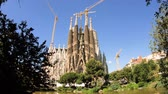 kuruluş : Cinematic Sagrada Familia Church built by Antoni Gaudi - cranes construction over the towers of the majestic cathedral