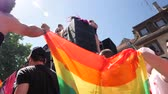 igualdade : STRASBOURG, FRANCE - JUN 10, 2017: Slow motion group excited friends people supporters dancing with rainbow flag in slow motion at LGBT GLBT visibility march pride