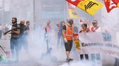 social worker : STRASBOURG, FRANCE - JUN 20, 2018: Smoke and noise grenade by SNCF French train worker demonstration strike protest against Macron French government string of reforms
