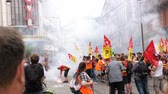 macron government : STRASBOURG, FRANCE - JUN 20, 2018: Large protest of SNCF French train worker demonstration strike protest against Macron French government string of reforms - smoke grenades flares
