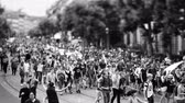 меньшинство : STRASBOURG, FRANCE - JUN 10, 2017: Black and white of tilt-shift lens focusing used at LGBT gay pride parade with thousands of people dancing on the street - elevated view