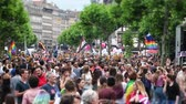 hoşgörü : STRASBOURG, FRANCE - JUN 10, 2017: Large crowd of cinematic tilt-shift lens at LGBT gay pride parade with thousands of people dancing on the street - elevated view Stok Video