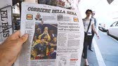 газета : PARIS, FRANCE - JUL 16, 2018: Man buying Corriere della sera newspaper announcing France champion title after French national football team won their FIFA World Cup 2018 final game against Croatia in Moscow
