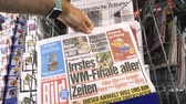 курение : PARIS, FRANCE - JUL 16, 2018: Man buying Die Bild German newspaper announcing France champion title after French national football team won their FIFA World Cup 2018 final game against Croatia in Moscow
