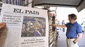 él : PARIS, FRANCE - JUL 16, 2018: Man buying El Pais newspaper announcing France champion title after French national football team won their FIFA World Cup 2018 final game against Croatia in Moscow