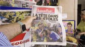şampiyon : PARIS, FRANCE - JUL 16, 2018: Man POV buying newspaper announcing France champion title after French national football team won their FIFA World Cup 2018 final game against Croatia in Moscow Stok Video