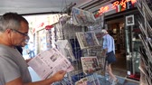 él : PARIS, FRANCE - JUL 16, 2018: Smoking man buying  newspaper announcing France champion title after French national football team won their FIFA World Cup 2018 final game against Croatia in Moscow