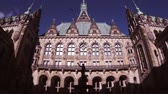 grande angular : Vintage VHS effect over the courtyard is decorated with a Hygieia fountain in majestic Hamburg City Hall Hamburger Rathaus facade the seat of local government of the Free and Hanseatic City of Hamburg Vídeos