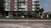 szocializmus : Sarajevo, Bosnia and Herzegovina - Circa 2018: View on typical Yugoslav residential buildings and shops as seen from inside a vehicle driving on the streets of Sarajevo cinematic vintage tape