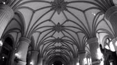almanca : HAMBURG, GERMANY - CIRCA 2018: Tilt-down motion to Hamburger Rathaus translated as Hamburg City Hall - wide interior with people tourists visiting the majestic interior with multiple decorations and pillars columns - black and white