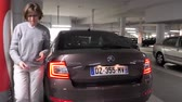 sofőr : HAARLEM, NETHERLANDS - CIRCA 2018: French tourist woman exits the parked Skoda Octavia car in the Parkee garage Raaks underground parking located on the Zijlvest 45, 2011 TJ Haarlem, Holland Stock mozgókép