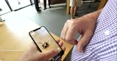 dimensões : STRASBOURG, FRANCE - SEP 21, 2018: Two people POV testing AR tape ruler of Apple wooden table on the newly released iPhone XS Max in Apple Store during the first sale day Vídeos
